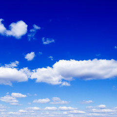 White fluffy clouds in the blue sky.