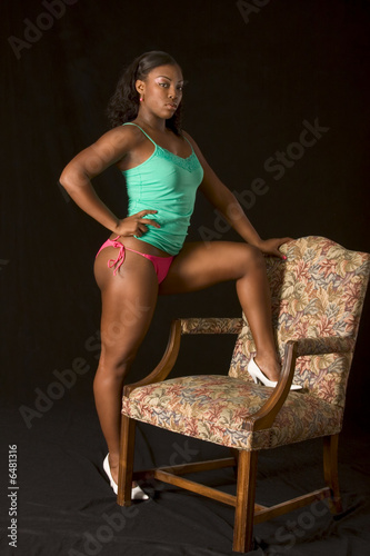 "sexy glamorous black girl in lingerie standingchair"" stock photo"
