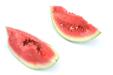 On a photo two pieces of a water-melon.