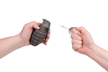 Hand grenade in a woman's hand with the pin pulled