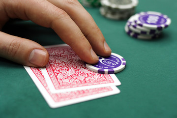 cards and chip in hand