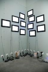 many screens on wall