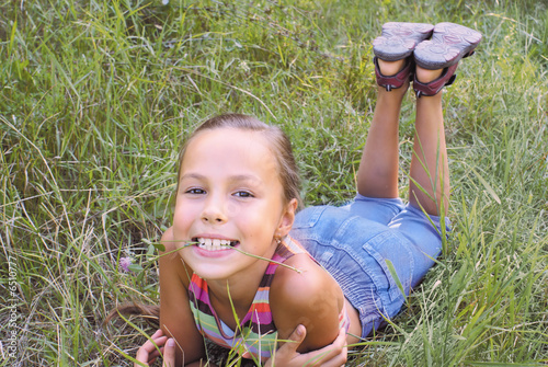 Preteen Girl On Grass Background Royalty Free Stock Photos