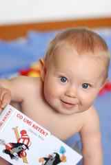 A baby with a book