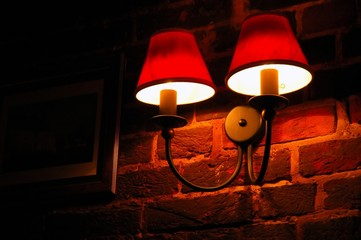 electric lamp on the ancient wall in the night time