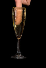 Finger in champagne glass