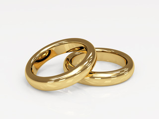 Two 3d gold wedding ring, laying on a glossy surface