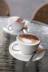 Two perfect cappuccinos