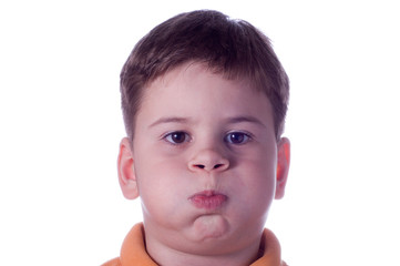 The Little boy has inflated cheeks