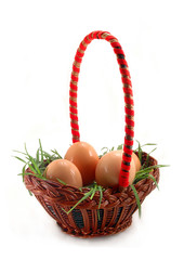 Easter basket with grass and white eggs