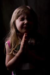 Child saying prayers