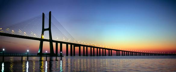 In de dag Brug Vasco da Gama bridge panorama at dusk