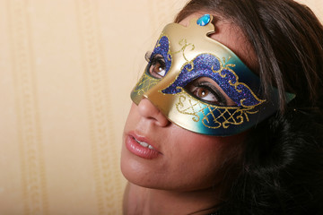 Sexy brunette woman in mask