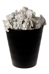Wastepaper basket full of crumpled paper isolated on white