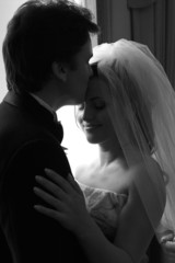 Bride and groom kissing in love