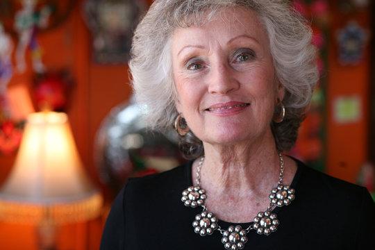 Elegant older woman with handmade silver jewlery