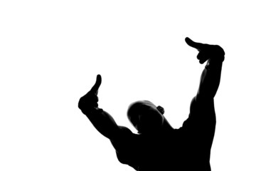 A silhouette of a man with his hands in the air.