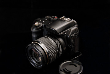 modern profesionalny camera SLR on the black background