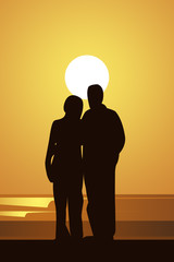 Sunset with couple embracing