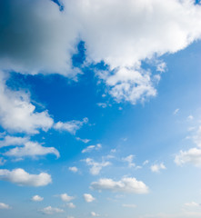 cloudscape of fluffy clouds in the blue sky