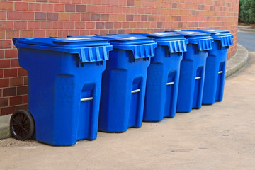 Blue garbage cans