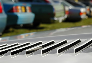 Wall Mural - sports car engine vent close-up in a parking lot