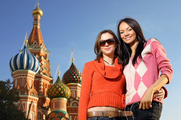 Two young women next to Saint Basil's Cathedral in Moscow