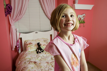 Little girl in her pink room