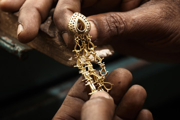 Goldsmith and earring.