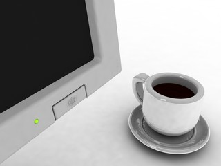 The switched off monitor and coffee cup. A break…