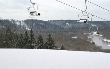 ski lift chairs over the hill