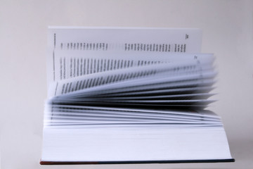 book with blown pages
