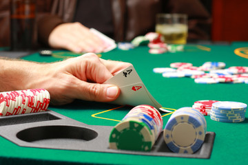 Man checking cards during poker game