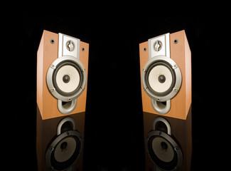 wooden audio speakers on black background