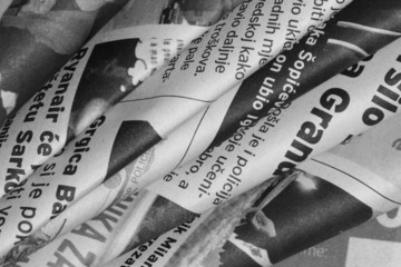 Newspaper leaves in black and white