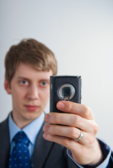 businessman taking a picture with his mobilephone