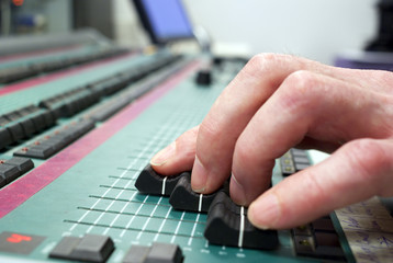 mixing desk and human hand