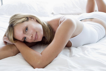 Young woman laying on bed