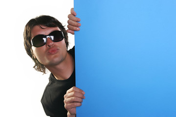 man holding a blue billboard with sunglasses