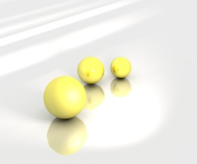 3 yellow spheres stand on gray plane