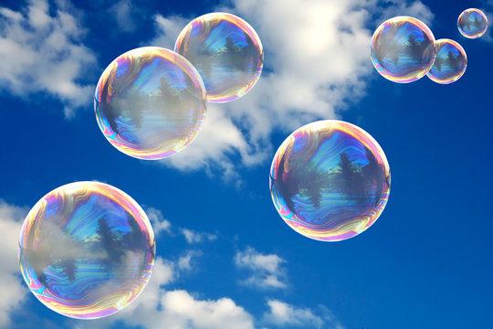Soap bubbles on blue sky