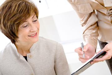 Senior businesswomen reviewing document