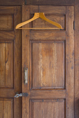 Wooden Hanger On Antique Closet