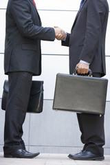 Detail of 2 businessmen meeting outside office