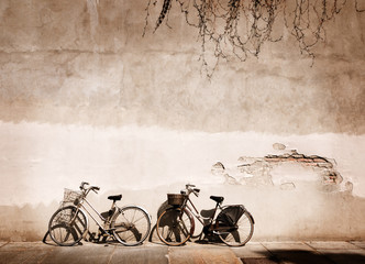 Wall Mural - Italian old-style bicycles leaning against a wall