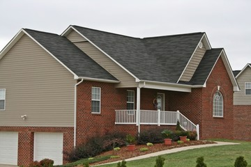 Two Story Brick Home With Garages