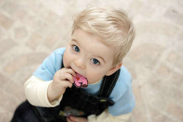 blond baby with toy