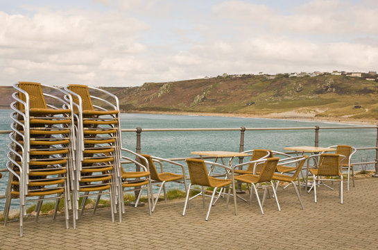 Stacked chairs by the beach