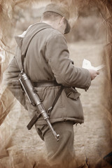 Letter from home.German soldier. WWII reenacting