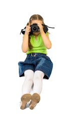 little girl shoots with dslr camera